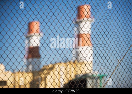 USA, New York City, Industrial plant behind wire mesh fence - Stock Photo