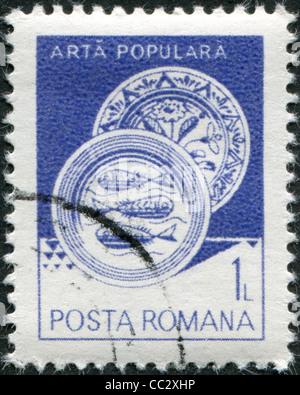 ROMANIA - CIRCA 1982: A stamp printed in the Romania, shows Ceramic plate, from Radauti, circa 1982 - Stock Photo