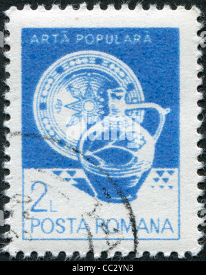 ROMANIA - CIRCA 1982: A stamp printed in the Romania, shows the Plate, jug, from Vama, circa 1982 - Stock Photo