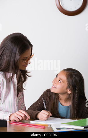 USA, California, Los Angeles, Mother doing homework with daughter (10-11)