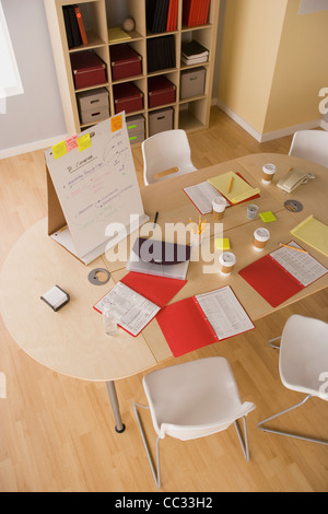 USA, California, Los Angeles, Table and office accessories after brainstorming session - Stock Photo