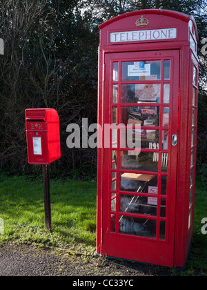 Disused rural red telephone box converted into a tourist information office - Stock Photo