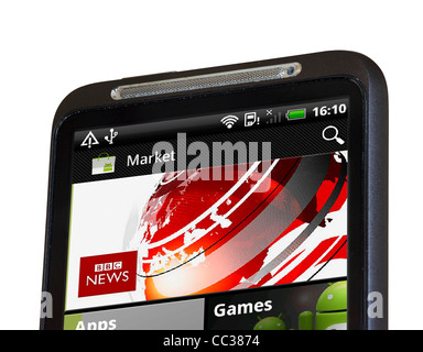 Browsing the Android Market on an HTC smartphone - Stock Photo