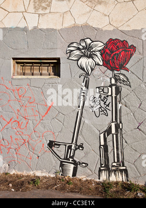 Shepard Fairey 'Guns and Roses' Wheatpaste street art in east Austin, Texas - Stock Photo
