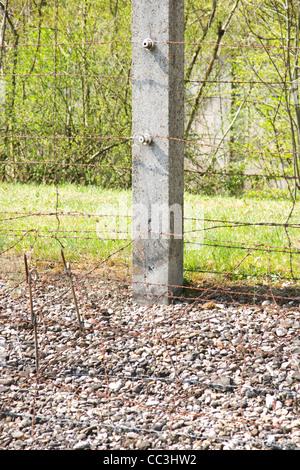 Barb Wire Fence in Dachau - Stock Photo