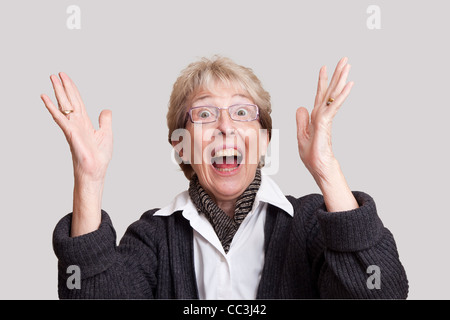 SENIOR CITIZEN WOMAN EXCLAIMING IN SURPRISE - Stock Photo