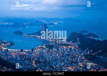 Brazil, Rio De Janeiro, Cosme Velho, View of Sugar Loaf mountain and Botafogo Bay from Cocovado at night - Stock Photo