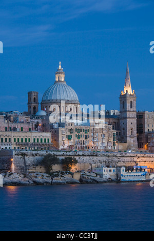 Malta, Valletta, skyline with St. Paul's Anglican Cathedral and Carmelite Church from Sliema - Stock Photo