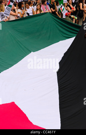 Palestinian flag during the march against the siege on Gaza in  London - England - Stock Photo