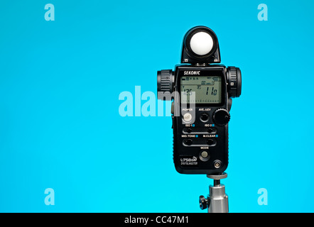 Sekonic L-758 Digital Master light meter vivid blue background with room for copy - Stock Photo