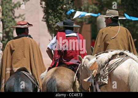 Gauchos on horseback in the Quebrada de Humahuaca, Jujuy province, Argentina - Stock Photo