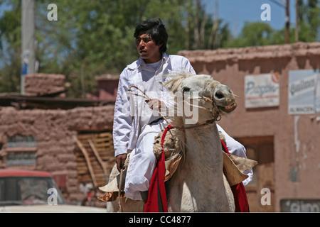 Gaucho on horseback in the Quebrada de Humahuaca, Jujuy province, Argentina - Stock Photo