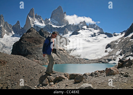 Tourist and view over Mount Fitz Roy and the Laguna de los Tres in the Andes, Patagonia, Argentina - Stock Photo