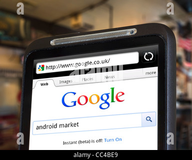 Performing a Google search on an HTC smartphone - Stock Photo