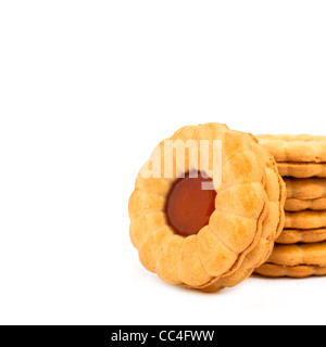 Sweet flower shaped cookies with marmelade fillings over white background. - Stock Photo