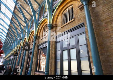 boutique shops inside covent garden market London England UK United kingdom - Stock Photo