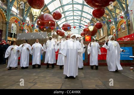 gospel choir singing at christmas inside covent garden market London England UK United kingdom - Stock Photo