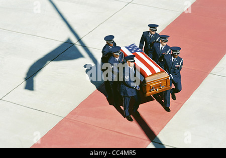 Robins Air Force Base Honor Guard members carry the casket of Senior Airman Michael Buras to an awaiting hearse - Stock Photo