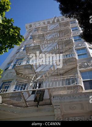 Fire escape stairs on a building, San Francisco, California, USA. - Stock Photo