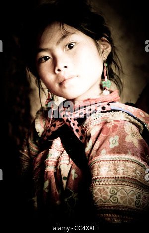 Portrait of a young girl from the Flower Hmong hill tribe at a village near Bac Ha, Northern Vietnam, South East - Stock Photo