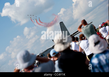 KECSKEMET, HUNGARY - AUGUST 8, 2010: spectators watch Turkish Stars display team flight in formation at Airshow - Stock Photo