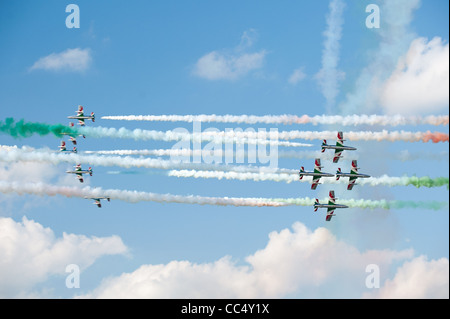 two groups of airplanes from Frecce Tricolori demoteam perform close crossing flight at Airshow - Stock Photo