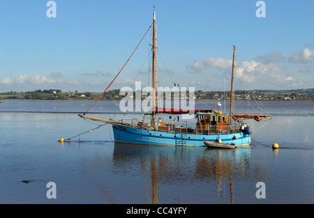 Classic twin masted sailing ship moored on the tidal River Exe below Topsham near Exeter below the Exeter ship canal - Stock Photo