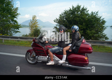 A red honda goldwing motorbike on the E50 road passing Liptovsky Mara (lake ) Slovakia - Stock Photo