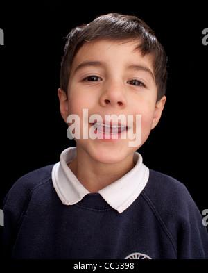 Boy smiling, studio shot - Stock Photo