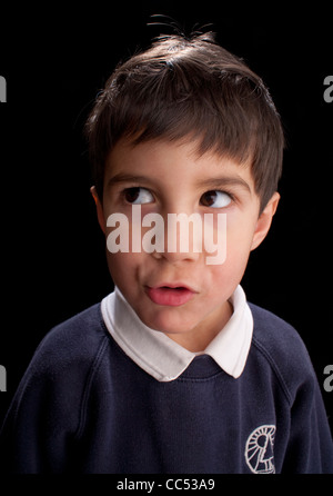 Boy looking away, studio shot - Stock Photo