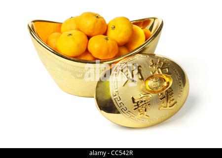 Mandarin oranges in gold ingot container on white background - Stock Photo