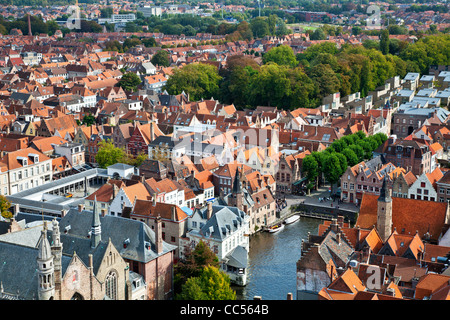Aerial view over rooftops, Rosary Quay and Vismarkt, fish market, in Bruges (Brugge),Flanders,Belgium taken from - Stock Photo