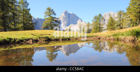Pond on top of a mountain Slemenova Špička in the background  beautiful view of the mountain Jalovec. - Stock Photo