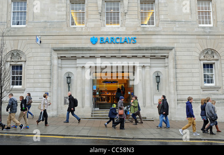 People walking past the large branch of Barclays Bank in North Street Brighton UK - Stock Photo
