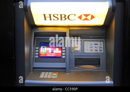 HSBC bank atm cash machine in wall British banking UK - Stock Photo