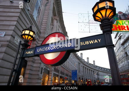 illuminated london underground entrance sign in piccadilly circus entrance to regent street central London England - Stock Photo