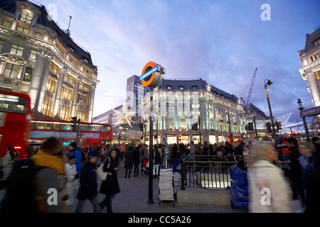 busy entrance to oxford circus tube station during evening rush hour London England UK United kingdom - Stock Photo