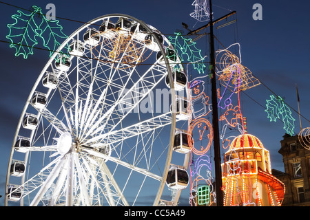 The temporary Christmas Observation Wheel on George Square, Glasgow, Scotland, UK - Stock Photo