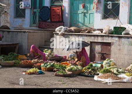 Two women selling produce in the street, Pushkar - Stock Photo