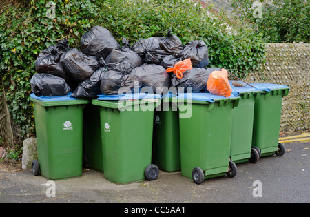 Rubbish bags and recycling wheelie bins awaiting collection in England, UK. - Stock Photo