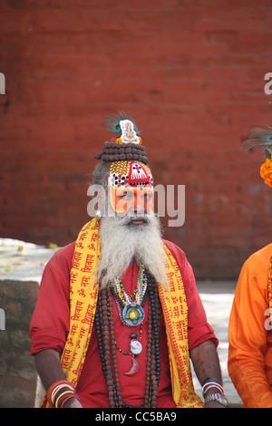 Portrait of colourful Sadhu holy man, Kathmandu, Nepal - Stock Photo