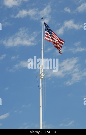 United States Flag flying over Fort Macon State Park. - Stock Photo