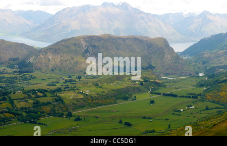 View from Coronet Peak looking over the Dalefield valley towards and Queenstown at the end of the valley  New Zealand - Stock Photo
