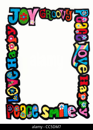 Embroidery iron on patches of Multicoloured Love, Peace, Happy, Smile and Joy words on a white background - Stock Photo