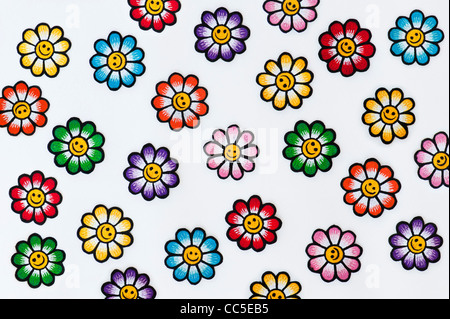 Embroidery iron on patches of Multicoloured smiley face flowers on a white background - Stock Photo