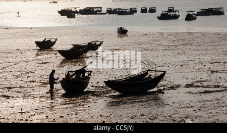 Fishing boat on sandy beach, Beihai, Guangxi , China - Stock Photo