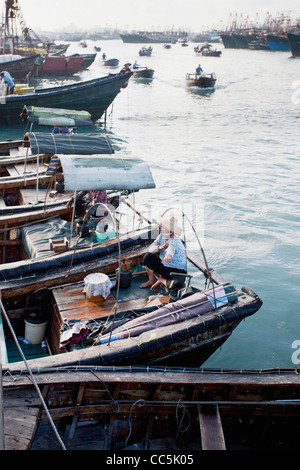 Fishermen coming back to the Seafood Market, Beihai, Guangxi , China - Stock Photo