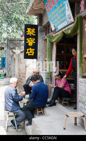 Locals playing poker together, Qikou Old Town, Lvliang, Shanxi , China - Stock Photo