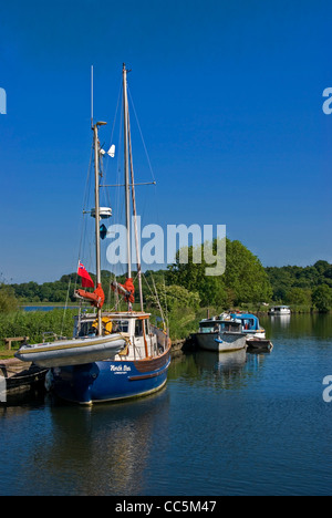 Boats and Sailing Ship Moored along the River Yare, Nr Thorpe St Andrew, on the Norfolk Broads, Norwich, Norfolk - Stock Photo