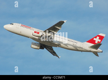 Swiss International Air Lines Airbus A320-200 (HB-IJJ) takes off from London Heathrow Airport, England. - Stock Photo